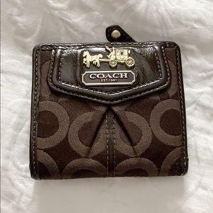 Coach signature bi-fold wallet brown with mauve